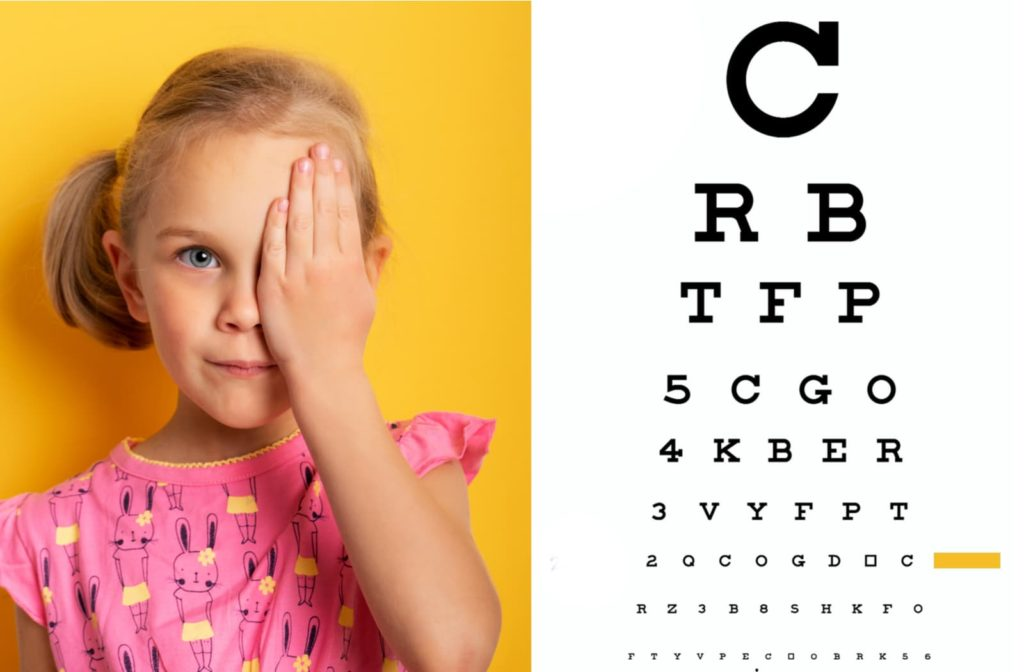 child with nystagmus doing an eye test while covering one eye