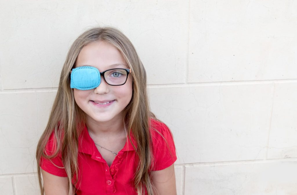 child with one eye covered to help treat her lazy eye