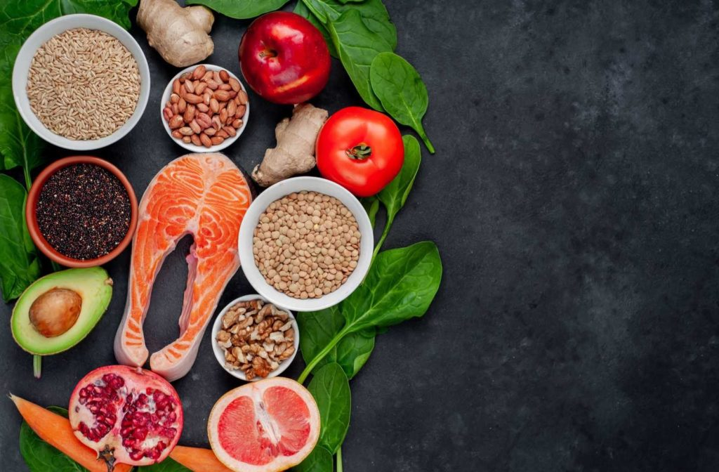 spread of eye healthy foods on charcoal background